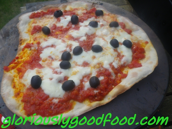 Pizza cooked on a Pizza Stone in the BBQ